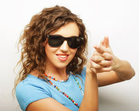 Funny girl in sunglasses with expression of surprise Royalty Free Stock Photography