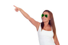 Funny girl with sunglasses indicating at side Stock Images
