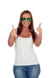 Funny girl with sunglasses saying Ok Stock Images