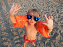 Funny girl in sunglasses on summer beach Royalty Free Stock Photo
