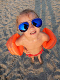 Funny girl in sunglasses on summer beach Stock Photo