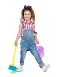 Funny girl sweeping the floor Royalty Free Stock Images