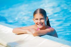 Funny girl swims. Stock Photo