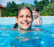 Funny girl swims. Royalty Free Stock Image