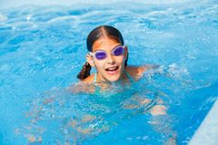 Funny girl swims. Stock Photos