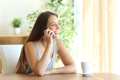Funny girl taking a phone conversation Royalty Free Stock Photo