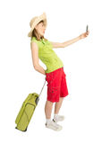 Funny girl tourist with green suitcase make photo. Royalty Free Stock Images