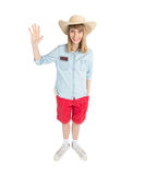 Funny girl tourist in straw hat in red shorts. Stock Images