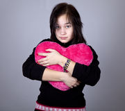 Funny girl with toy heart. Royalty Free Stock Photography