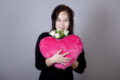Funny girl with toy heart. Royalty Free Stock Image