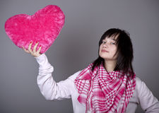 Funny girl with toy heart. Stock Photos