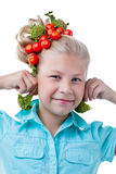 Funny girl tries on broccoli as earring Royalty Free Stock Images