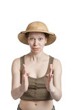 Funny girl in a tropical helmet holds palms ahead of itself. On a white backgroung Stock Photos
