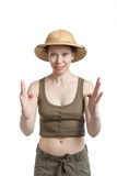 Funny girl in a tropical helmet holds palms ahead of itself. On a white backgroung Royalty Free Stock Photo