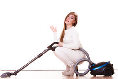Funny girl with vacuum cleaner. Housework Stock Images