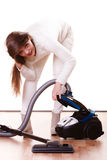 Funny girl with vacuum cleaner. Housework Royalty Free Stock Photography