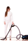 Funny girl with vacuum cleaner. Housework Stock Image