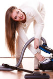 Funny girl with vacuum cleaner. Housework. Woman vacuuming the house. Funny girl with vacuum cleaner. Housework Stock Images
