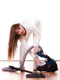 Funny girl with vacuum cleaner. Housework. Woman vacuuming the house. Funny girl with vacuum cleaner. Housework Royalty Free Stock Photos
