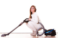 Funny girl with vacuum cleaner. Housework. Woman vacuuming the house. Funny girl with vacuum cleaner. Housework Stock Photos