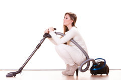 Funny girl with vacuum cleaner. Housework. Woman vacuuming the house. Funny girl with vacuum cleaner. Housework Royalty Free Stock Images