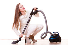 Funny girl with vacuum cleaner. Housework Royalty Free Stock Photo