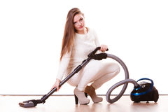 Funny girl with vacuum cleaner. Housework Stock Photography