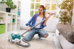 Funny girl with vacuum cleaner Stock Photo