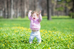 Funny girl walking in a sunny park Stock Photos