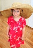 Funny girl wearing huge hat Royalty Free Stock Photos