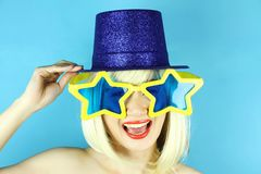 Funny girl wearing star shaped glasses, Playful girl with funny glasses. Royalty Free Stock Images