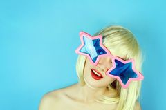 Funny girl wearing star shaped glasses, Playful girl with funny glasses. Royalty Free Stock Photo