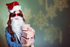 Funny girl wearing xmas santa hat and beard Stock Photos