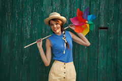 Funny girl with weather vane Stock Photos