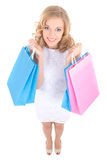 Funny girl in white dress with shopping bags Royalty Free Stock Photo