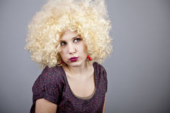 Funny girl in wig. Stock Image