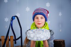 Funny girl in winter clothes. Royalty Free Stock Photography