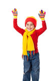 Funny girl in winter clothes. With raised hands, isolated on white Stock Photo