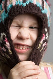 Funny girl in winter hat. Closeup funny portrait of little girl in winter hat stock photo