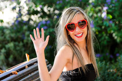 Funny Girl With Red Heart Glasses Royalty Free Stock Photography