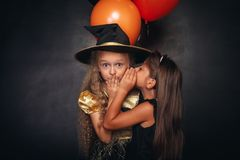 Funny girls with balloons sharing secret