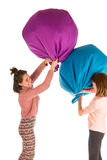 Funny girls fighting with beanbag chairs Royalty Free Stock Image