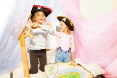 Funny girls in pirate's costumes steering the ship Stock Images