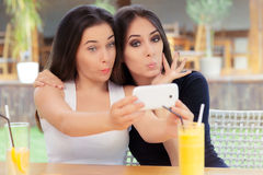 Funny Girls Taking a Selfie Together Stock Images