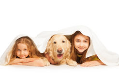 Funny girls and their pet covered with white towel Royalty Free Stock Photos