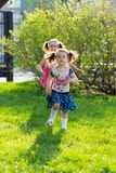 Funny girls walking on the lawn with her mother. Sisters play together with mom. maternal care. happy family stock photos