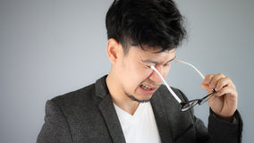 Funny glasses Asian businessman. Royalty Free Stock Photo