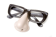 Funny glasses novelty disguise. Funny glasses and nose novelty disguise isolated against a white background Royalty Free Stock Image