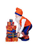Funny gnome with christmass presents Royalty Free Stock Photos