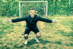 Funny goalkeeper at playground with stupid big empty glasses. Joke concept of blindness with playful attitude approach to sport competition stock photo